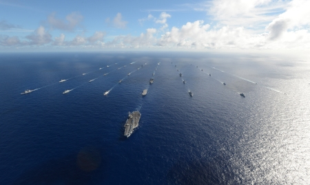 Forty-two ships and submarines representing 15 international partner nations steam in close formation during Rim of the Pacific (RIMPAC) Exercise 2014. Twenty-two nations, more than 40 ships and six submarines, more than 200 aircraft and 25,000 personnel are participating in RIMPAC exercise from June 26 to Aug. 1, in and around the Hawaiian Islands and Southern California. The world's largest international maritime exercise, RIMPAC provides a unique training opportunity that helps participants foster and sustain the cooperative relationships that are critical to ensuring the safety of sea lanes and security on the world's oceans. RIMPAC 2014 is the 24th exercise in the series that began in 1971. (U.S. Navy photo by Mass Communication Specialist 1st Class Shannon Renfroe/Released)